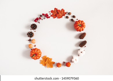 Autumn composition. Wreath made of pumpkins, flowers, leaves on gray background. Autumn, fall, halloween, thanksgiving day concept. Flat lay, top view, copy space