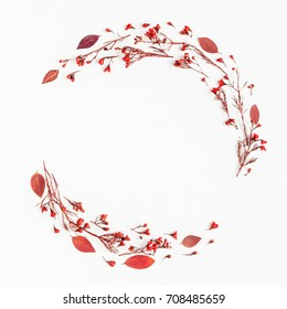 Autumn composition. Wreath made of autumn red leaves and flowers. Flat lay, top view, copy space, square