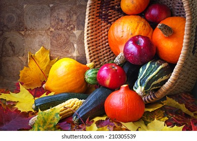 Autumn concept with seasonal fruits and vegetables/organic food background; Autumn harvest with Farmers Vegetable fruits on dark wooden background/ Thanksgiving day concept