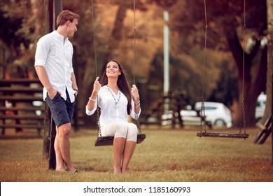 autumn couple having fun in the park