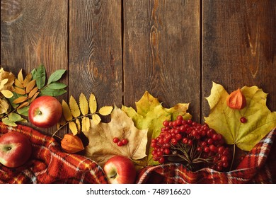 Autumn coziness ripe leaves mix wood surface concept. Colourful fall background.