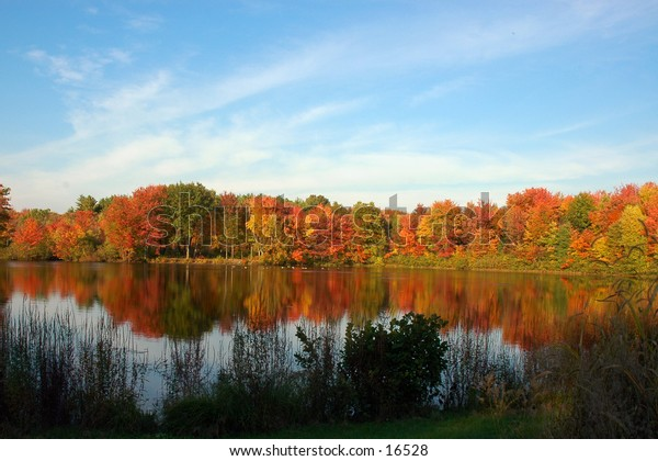 Autumn day reflected in New England pond