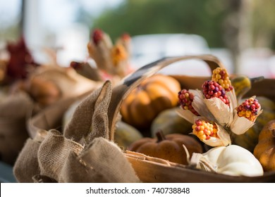 Autumn decoration with leaves, basket, and pumpkin.