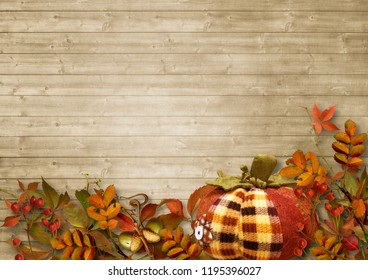 Autumn decoration with pumpkin and red berries on wooden backgro