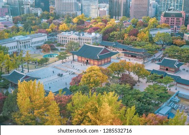 Autumn of Deoksugung royal palace and Seoul City Hall from Top view in Seoul, South Korea.