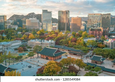 Autumn of Deoksugung royal palace and Seoul City Hall from Top view in Seoul , South Korea.