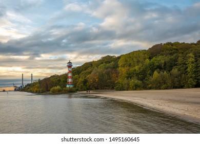 Autumn evening mood at the lighthouse on the Elbe near Hamburg
