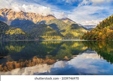 Autumn evening at the mountain lake Ritsa. Abkhazia.