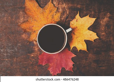 Autumn Fall Background  with maple leaves and cup of black coffee - Autumn Card for your design, top view with copy space