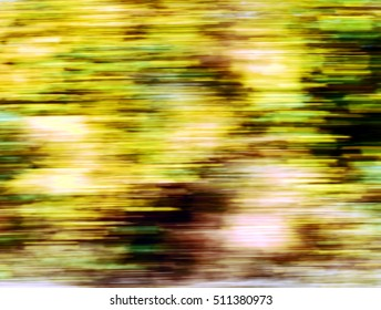 Autumn fall colourful leaves blurred motion abstract.