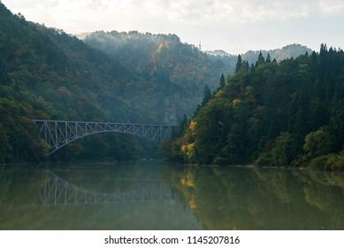 Autumn fall foliage Fukushima First Bridge daiichi kyouryou from Tadami River bank  in Mishima Fukushima Japan