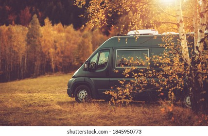 Autumn Fall Foliage RV Recreational Vehicle Camper Van Road Trip and Scenic Camping in Beautiful Place. Motorhome and the Scenic Nature. Travel Theme. - Shutterstock ID 1845950773