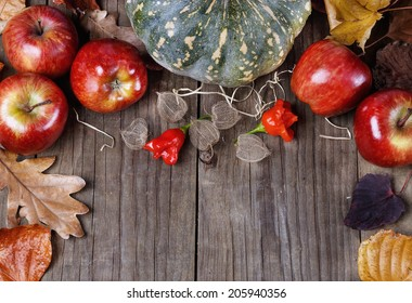 Autumn (fall) still life: pumpkin, apples, and peri peri capsicum