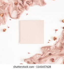 Autumn fashion composition. Paper blank, textile, dried flowers and leaves on white background. Autumn, fall concept. Flat lay, top view, copy space, square