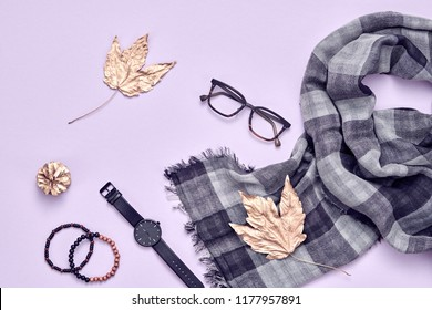 Autumn Fashion. Man casual Outfit with accessories, lifestyle concept. Minimal Creative Flat lay. Trendy Scarf, Stylish Watch and Glasses. Fall Hipster Guy, Maple Leaf.