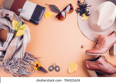 Autumn female outfit. Set of clothes, shoes and accessories on brown background