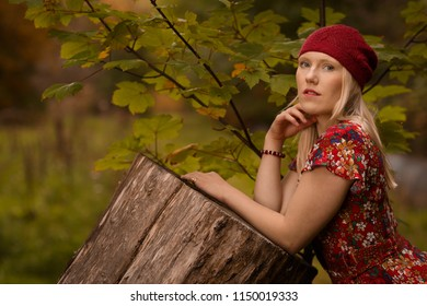 Autumn Festival, Arrowtown, New Zealand - Apr 6th 2018: Beautiful young woman poses amongst the autumn coloured trees in the Arrowtown domain