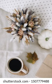 Autumn flat lay. Seasonal home autumn decoration with dried leaves and pumpkin. Thanksgiving, Halloween and fall concept.