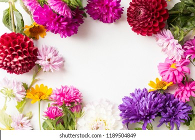 autumn flowers frame on white background. asrers and dahlias