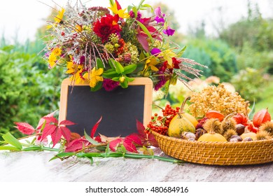 Autumn flowers, autumn fruits, chalkboard