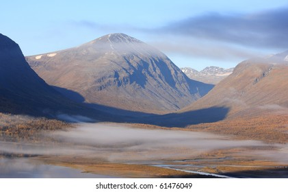Autumn fog and colors in an beautiful Arctic valley.