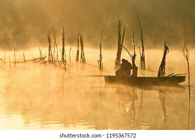 Its a autumn foggy morining,the sun is rising and the fisherman on the danube river trying to catch his fish .