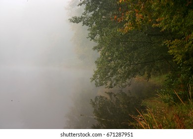 Autumn foggy morning on the lake - Shutterstock ID 671287951
