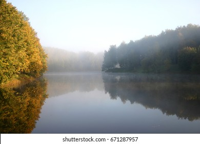 Autumn foggy morning on the lake - Shutterstock ID 671287957