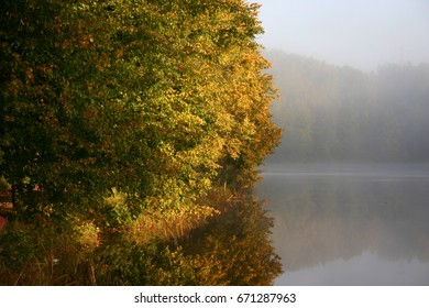 Autumn foggy morning on the lake - Shutterstock ID 671287963