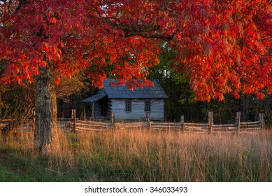 Autumn foliage frames this old one room schoolhouse in the Cumberland Gap National Park.