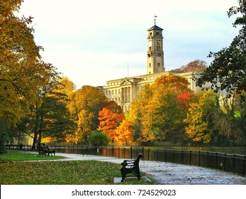 Autumn foliage in Highfield park, overseeing the lake and University of Nottingham 's Trent Building. Autumn 2011