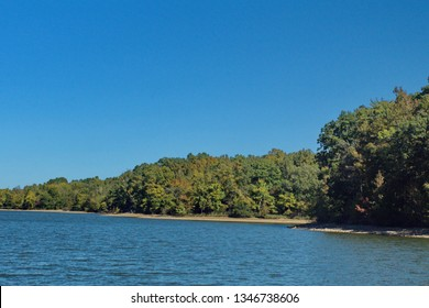 Autumn foliage on the shore of the Ohio River in Land Between the Lakes park in Paducah, Kentucky, USA