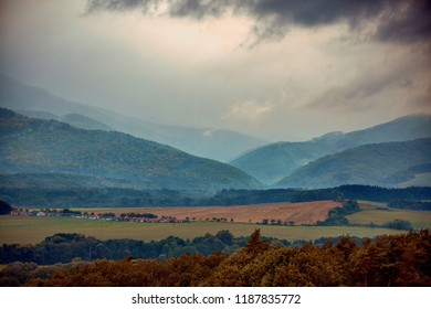 Autumn forest after rain, dramatic sky with dense cloud in the background of beautiful Slovak mountains. Europe, country Slovakia, region Horna Nitra, village Malinova