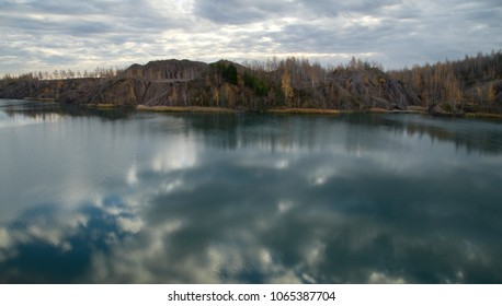Autumn Forest Around the Lake in an Abandoned Quarry