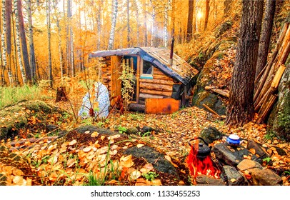 Autumn forest hunting hut landscape. Hunting hut in autumn forest. Forest hunting hut in autumn forest scene