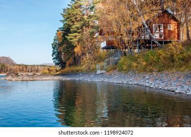 Autumn forest hunting hut landscape. Hunting hut in autumn forest. Forest hunting hut in autumn forest scene
