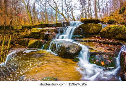 Autumn forest river waterfall stones landscape. Forest waterfall river in autumn season. Autumn waterfall river view