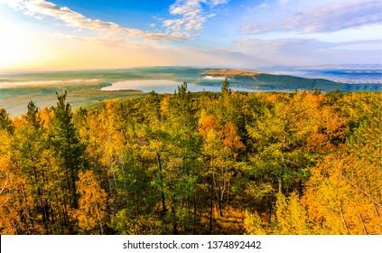 Autumn forest top view landscape. Forrest trees top view in autumn season. Autumn forest trees top view panorama. Autumn forrest trees top view landscape