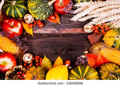 Autumn frame: composition with pumpkins, dried flowers, apples, rose hips.  Space for text.