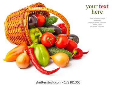 Autumn fresh vegetables in basket on white, food photo