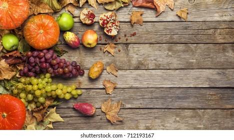 Autumn fruit banner, leaves on wooden floor