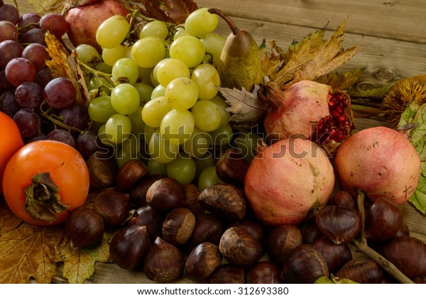 Autumn fruit, texture, grapes, persimmons, pears, pomegranates and chestnuts