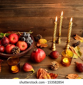 Autumn fruits with candles.image of autumn season.