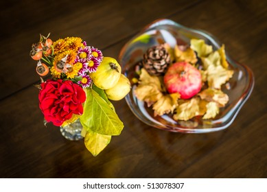 Autumn fruits and flowers on wooden table
