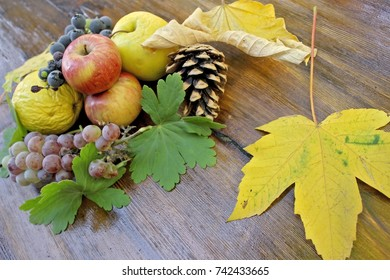 Autumn fruits on a wooden table