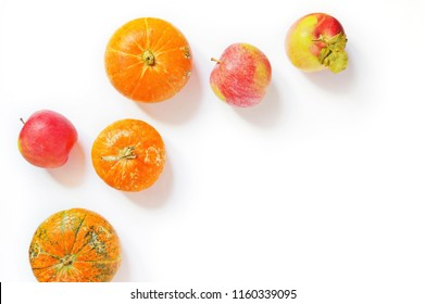Autumn fruits and vegetables photo view from above. Small pumpkins and red apples. Flat lay food photography. Free space for text, mockup for blog design