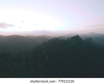 Autumn full moon foggy night. Wooden cabin on main hill  peak. Quite landscape,  dark purple sky, creamy autumn mist in valley bellow.