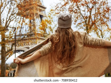 Autumn getaways in Paris. Seen from behind young tourist woman in Paris, France having fun time