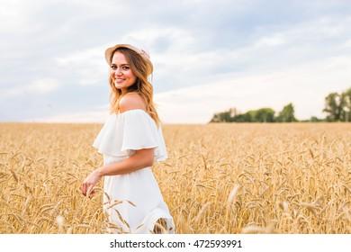Autumn Girl enjoying nature on the field. Free Happy Woman