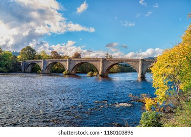 Autumn glow on a sunny day on the Thomas Telford designed bridge at Dunkeld Perthshire Scotland. It spans the River Tay, the longest river in Scotland.